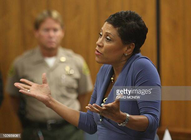 US actress Lindsay Lohan's lawyer Shawn Chapman Holley talks to Judge Marsha Revel during her hearing at the Beverly Hills Courthouse on July 6 2010...