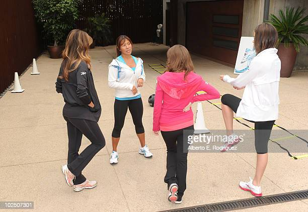 Actress Lindsay Price fitness trainer Yumi Lee actresses Anna Kendrick and Emmy Rossum attend the Reebok Women's Fitness event on June 16 2010 in Los...