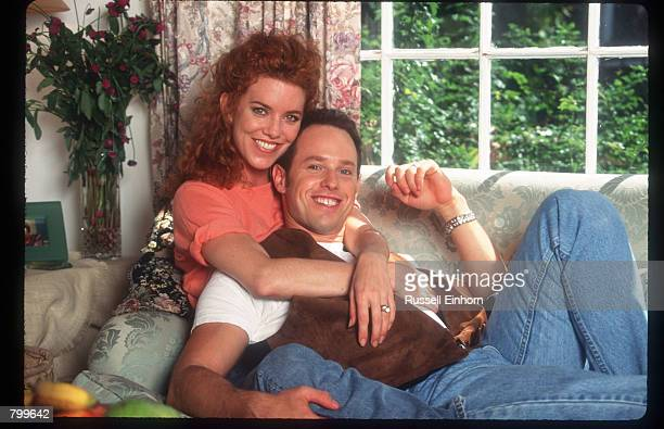 Actress Lisa Akey and husband Raphel Sbarge sit on their couch at home August 18 1995 in Los Angeles CA Akey the star of the new Aaron Spelling tv...