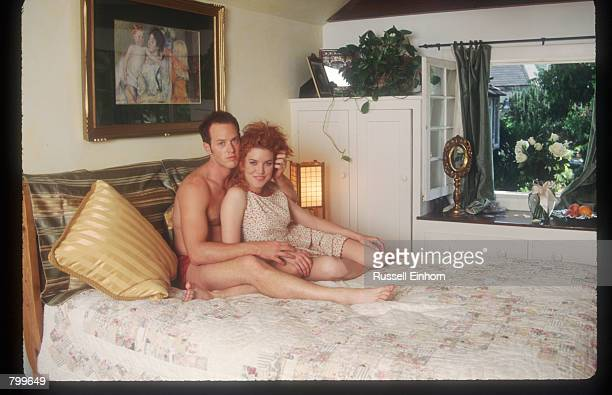 Actress Lisa Akey and husband Raphel Sbarge sits on their bed at home August 18 1995 in Los Angeles CA Akey the star of the new Aaron Spelling tv...