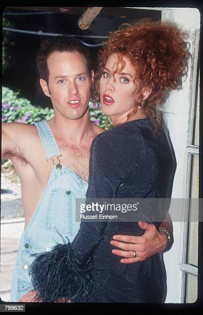 Actress Lisa Akey and husband Raphel Sbarge stand together August 18 1995 in Los Angeles CA Akey the star of the new Aaron Spelling tv series Model's...