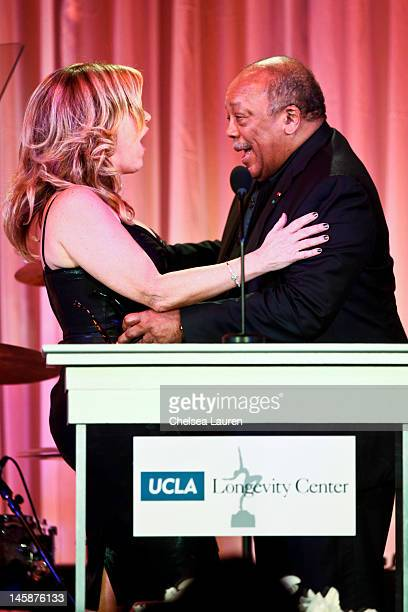 Actress Lisa Ann Walter and producer Quincy Jones attend the 2012 ICON Awards at Beverly Hills Hotel on June 6 2012 in Beverly Hills California