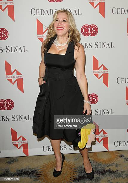 Actress Lisa Ann Walter attends the Helping Hand of Los Angeles' 84th annual Mother's Day luncheon at the Beverly Hills Hotel on May 10 2013 in...