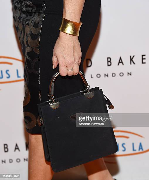 Actress Lisa Ann Walter handbag and bracelet detail arrives at the 13th Annual Lupus LA Hollywood Bag Ladies Luncheon at The Beverly Hilton Hotel on...