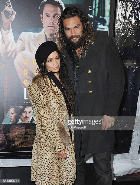 Actress Lisa Bonet and actor Jason Momoa arrive at the Premiere of Live By Night at TCL Chinese Theatre on January 9 2017 in Hollywood California