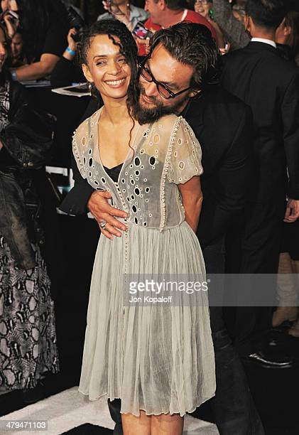 Actress Lisa Bonet and husband actor Jason Momoa arrive at the Los Angeles Premiere Divergent at Regency Bruin Theatre on March 18 2014 in Los...