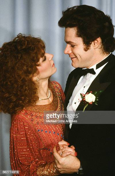Actress Lisa Eilbacher and actor David Keith pose backstage during the 55th Academy Awards at Dorothy Chandler Pavilion Los Angeles California