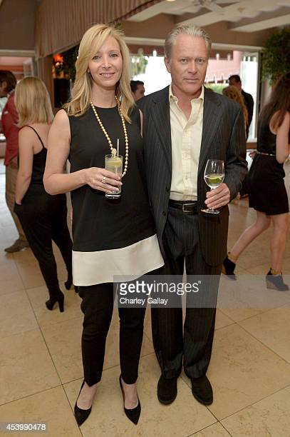 Actress Lisa Kudrow and advertising executive Michel Stern attend the Vanity Fair and Maybelline New York toast of the EmmyNominated VEEP on August...