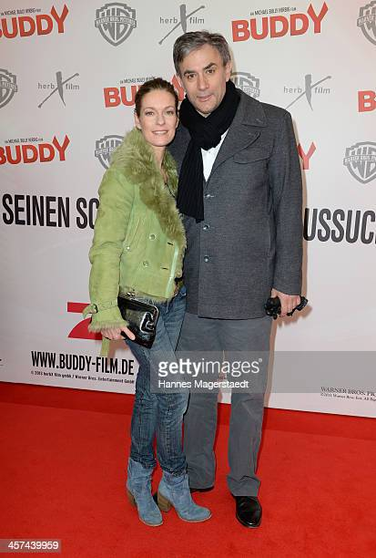 Actress Lisa Martinek and her husband Giulio Ricciarelli attend 'Buddy' Premiere at Mathaeser Filmpalast on December 17 2013 in Munich Germany