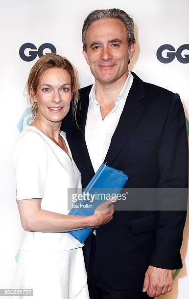 Actress Lisa Martinek wearing a dress by Hugo Boss and a handbag by Prada and her husband Giulio Ricciarelli attend the GQ Care Award 2016 at The...
