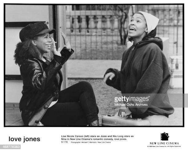 Actress Lisa Nicole Carson and actress Nia Long on set of the New Line Cinema movie ' Love Jones' circa 1997