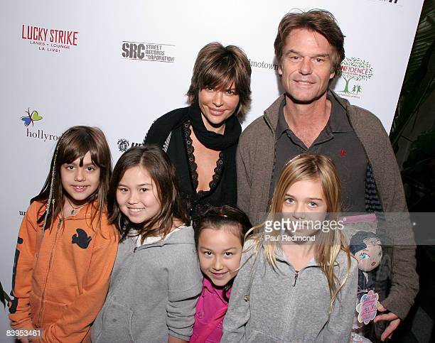Actress Lisa Rinna actor Harry Hamlin and family attend attends Children's Holiday Bowl and Toy Drive benefiting the Children of South LA's youth...