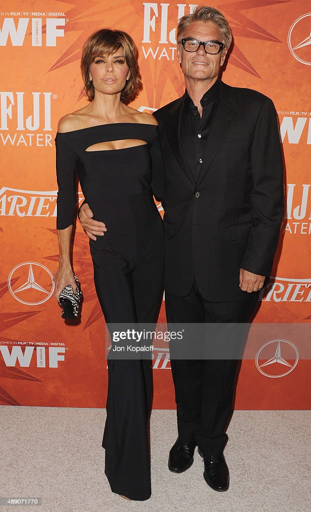 Actress Lisa Rinna and actor Harry Hamlin arrives at the Variety And Women In Film Annual Pre-Emmy Celebration at Gracias Madre on September 18, 2015 in West Hollywood, California.