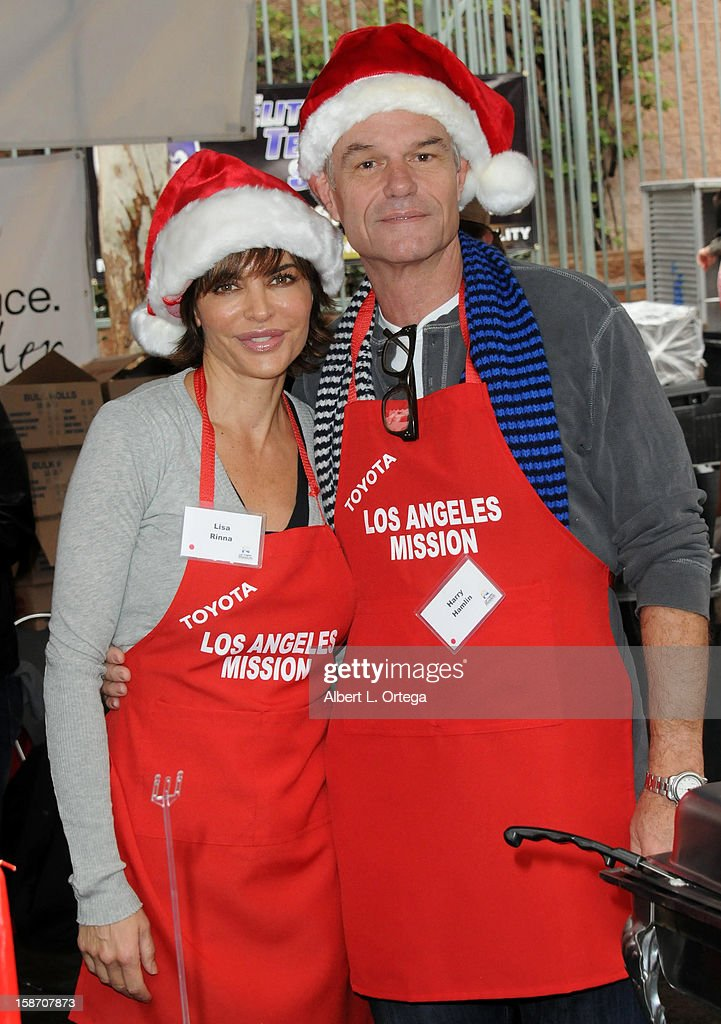Actress Lisa Rinna and actor Harry Hamlin participate in the Los Angeles Mission Christmas Eve lunch For The Homeless held at the Los Angeles Mission on December 24, 2012 in Los Angeles, California.