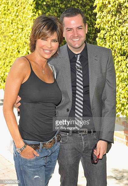 Actress Lisa Rinna and host of Inside Dish Ross Mathews participate in the 'Honk If You Love Lisa Rinna' Campaign on March 18 2009 in Los Angeles...