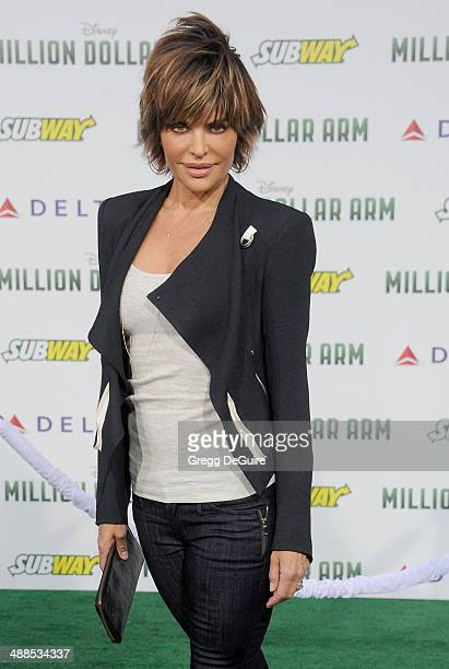 Actress Lisa Rinna arrives at the Los Angeles premiere of 'Million Dollar Arm' at the El Capitan Theatre on May 6 2014 in Hollywood California