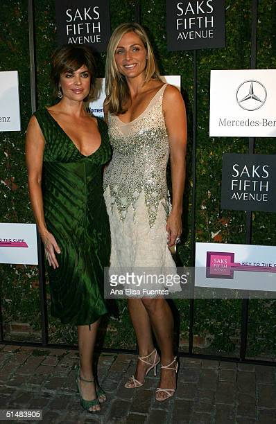 Actress Lisa Rinna greets host Jamie Tisch during the arrival of the Saks Fifth Avenue A Key To The Cure benefit event at a private residence on...