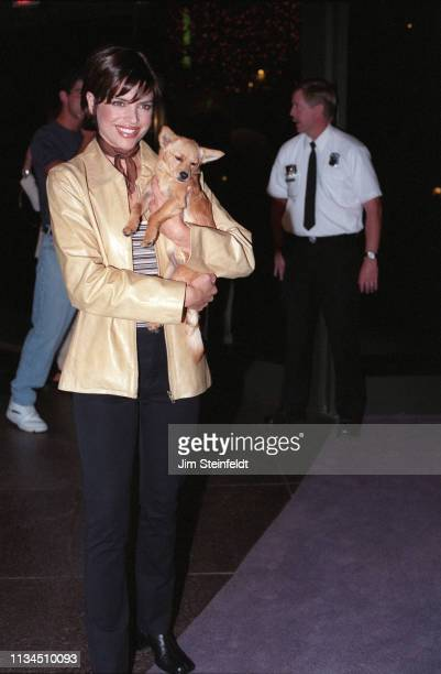Actress Lisa Rinna holding a puppy dog at the Amanda Foundation Benefit on September 26 1996