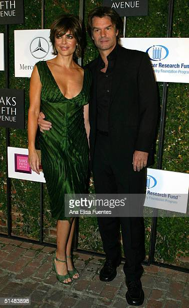 Actress Lisa Rinna with husbandactor Harry Hamlin during the arrival at the the Saks Fifth Avenue A Key To The Cure benefit event at a private...