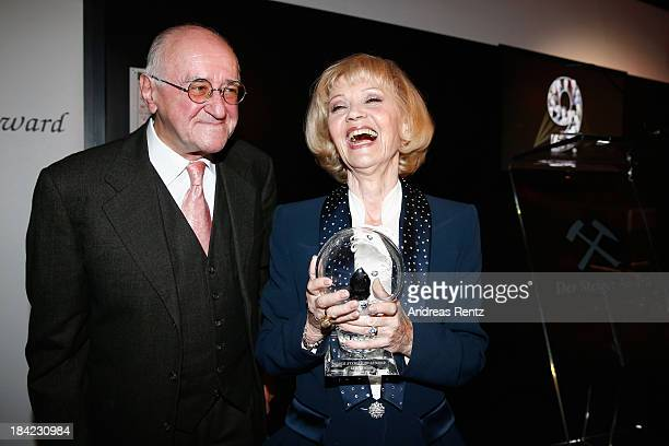 Actress Liselotte Pulver poses with her award as laudatio Alfred Biolek smiles during the Steiger Award 2013 at Dortmunder U on October 12 2013 in...