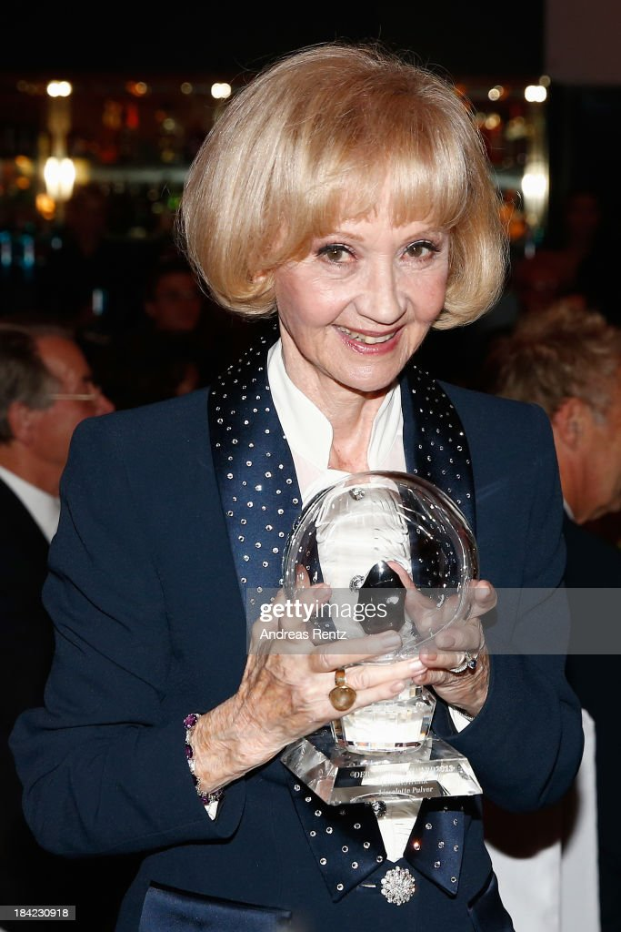 Actress Liselotte Pulver poses with her award during the Steiger Award 2013 at Dortmunder U on October 12, 2013 in Dortmund, Germany. Pulver received the lifetime achievement award.