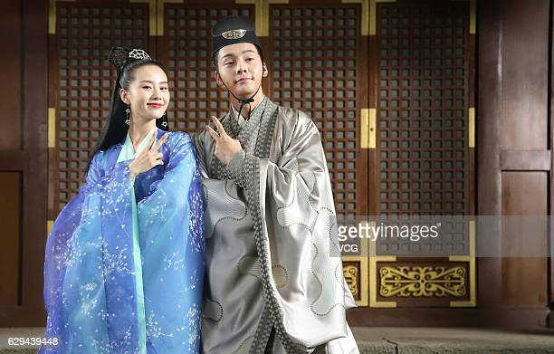 """Actress Liu Shishi and actor William Chan Wai-ting pose during the interviews at the shooting site of ancient costume TV drama """"Lost Love in Times""""..."""