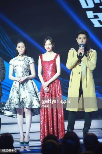 Actress Liu Yifei actress Tiffany Tang and actor Huang Zitao arrive at the red carpet of L'Officiel Fashion Night 2017 on November 29 2017 in Beijing...