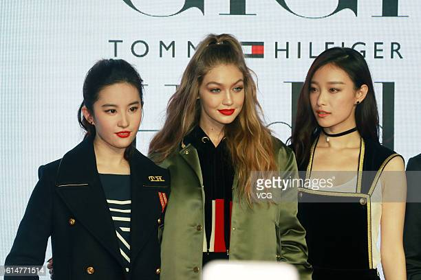 Actress Liu Yifei American model Gigi Hadid and actress Ni Ni attend commercial activity of Tommy Hilfiger on October 14 2016 in Shanghai China