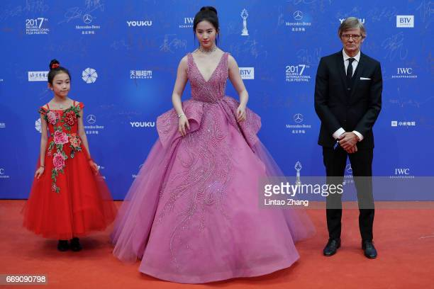 Actress Liu Yifei and Danish film director Bille August arrives at the red carpet of the 7th Beijing International Film Festival on April 16 2017 in...