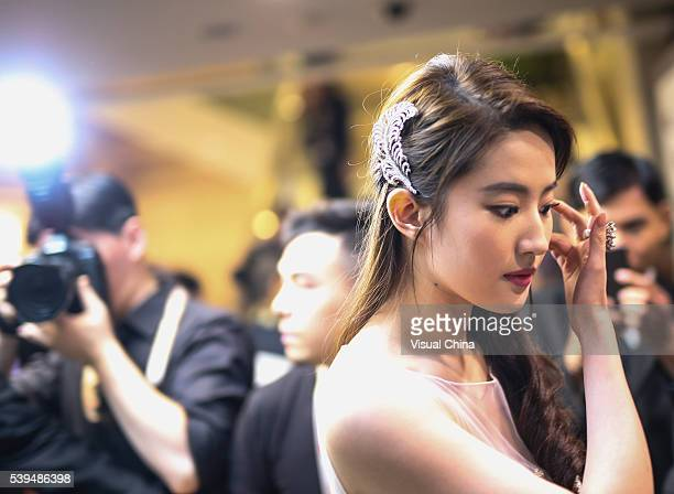 Actress Liu Yifei arrives for the red carpet of the 19th Shanghai International Film Festival at Shanghai Grand Theatre on June 11 2016 in Shanghai...