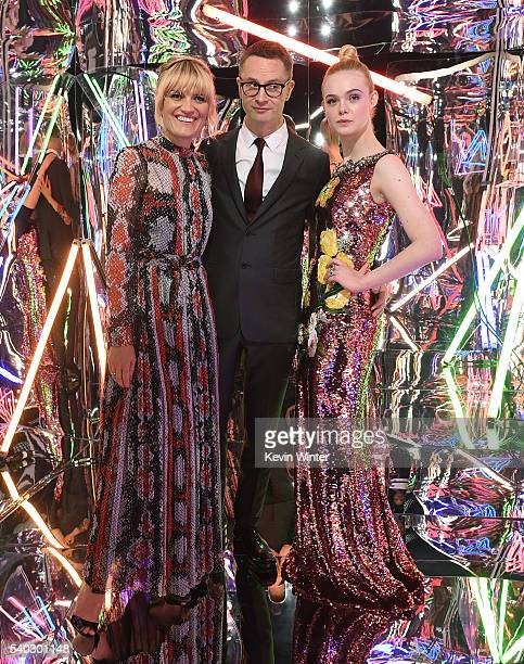 Actress Liv Corfixen director Nicolas Winding Refn and actress Elle Fanning pose at the after party for the premiere of Amazon's The Neon Demon at...