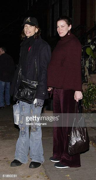 Actress Liv Tyler anad her father musician Steven Tyler stand on the street December 11 2004 in New York City