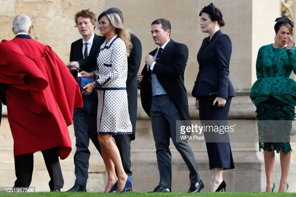 US actress Liv Tyler and British model Kate Moss arrive to attend the wedding of Britain's Princess Eugenie of York to Jack Brooksbank at St George's...