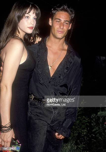 Actress Liv Tyler and Model/Actor Nick Scotti attends the Second Annual Boathouse Rock Dance Party to Benefit amfAR on June 28 1993 at the Loeb...