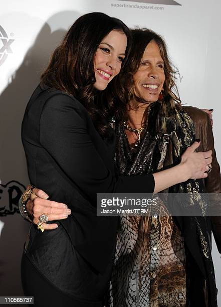 """Actress Liv Tyler and musician Steven Tyler arrive at the premiere of IFC Midnight's """"Super"""" at the Egyptian Theatre on March 21, 2011 in Hollywood,..."""