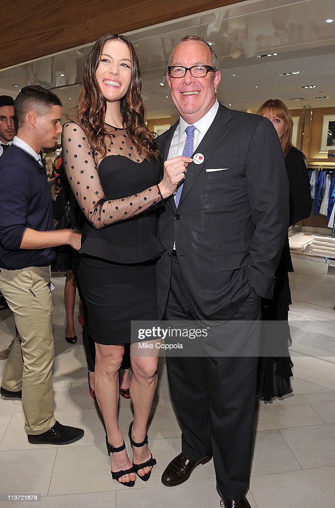 Actress Liv Tyler (L) and President and CMO of Saks Fifth Avenue, Ron Frasch attend the launch of the new Stella McCartney boutique at Saks Fifth Avenue on May 4, 2011 in New York City.