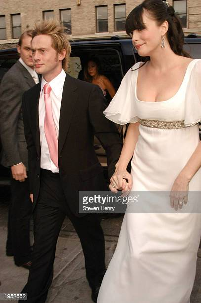 Actress Liv Tyler arrives at her wedding reception with her husband Royston Langdon in lower Manhattan April 25 2003 in New York City