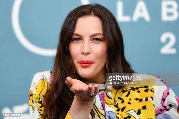 US actress Liv Tyler blows a kiss during a photocall on August 29 2019 for the film Ad Astra during the 76th Venice Film Festival at Venice Lido