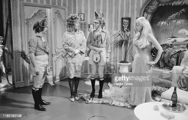 Actress Liz Fraser and comedians Bill Oddie Tim BrookeTaylor and Graeme Garden in a sketch from episode 'Caught in the Act' of the BBC television...