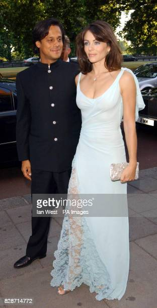 Actress Liz Hurley and boyfriend Arun Nayar arriving at the Grosvenor House Hotel in London's Park Lane for the Grosvenor House Art Antiques Fair...