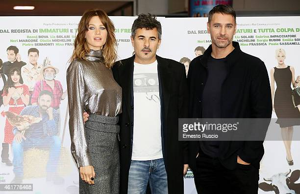 Actress Liz Solari director Paolo Genovese and actor Raoul Bova attend the 'Sei mai stata sulla luna' photocall at Cinema Adriano on January 19 2015...