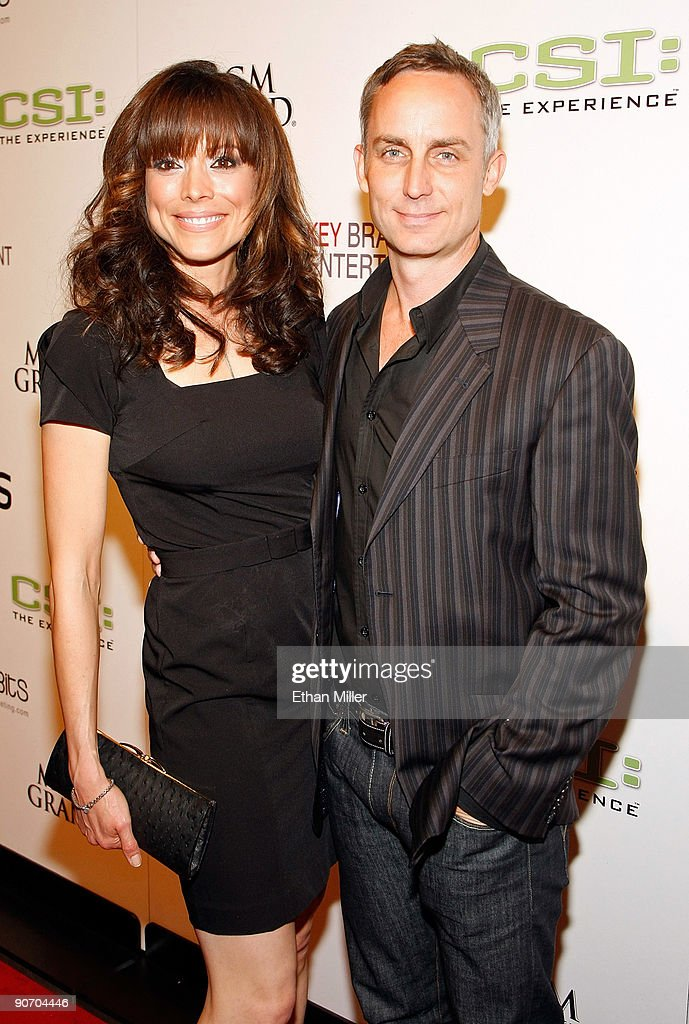 actress liz vassey and actor wallace langham arrive at the grand