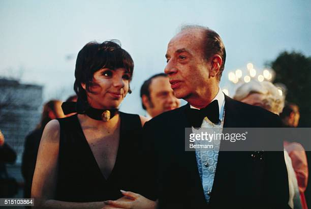 Actress Liza Minnelli, an Oscar candidate, enters the Academy Awards Ceremonies with her father, famed director Vincent Minelli. Miss Minelli,...