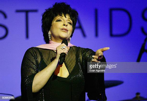 Actress Liza Minnelli speaks on stage during the auction at Cinema Against AIDS 2004 the 11th annual event in aid of amfAR at Le Moulin de Mougins at...