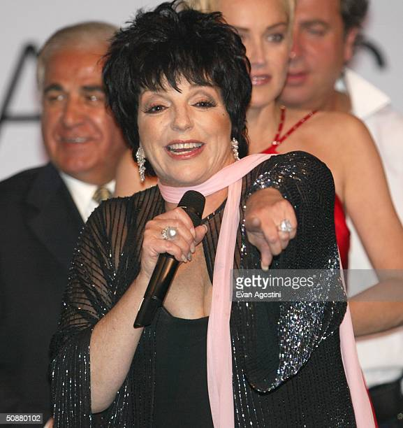"""Actress Liza Minnelli speaks on stage during the auction at """"Cinema Against AIDS 2004"""", the 11th annual event in aid of amfAR at Le Moulin de Mougins..."""