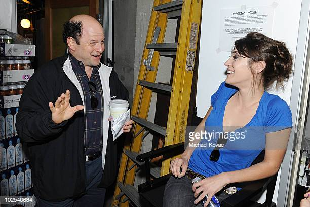Actress Lizzy Caplan and actor Jason Alexander chat before competing on TheRoomlivecom's 'Celebrity Liar' at TheRoomLive Studio on June 29 2010 in...