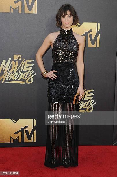 Actress Lizzy Caplan arrives at the 2016 MTV Movie Awards at Warner Bros Studios on April 9 2016 in Burbank California