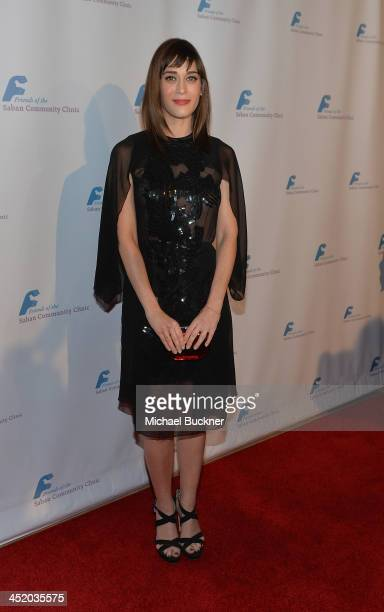 Actress Lizzy Caplan arrives at the 37th Annual Saban Community Clinic Gala at The Beverly Hilton Hotel on November 25 2013 in Beverly Hills...