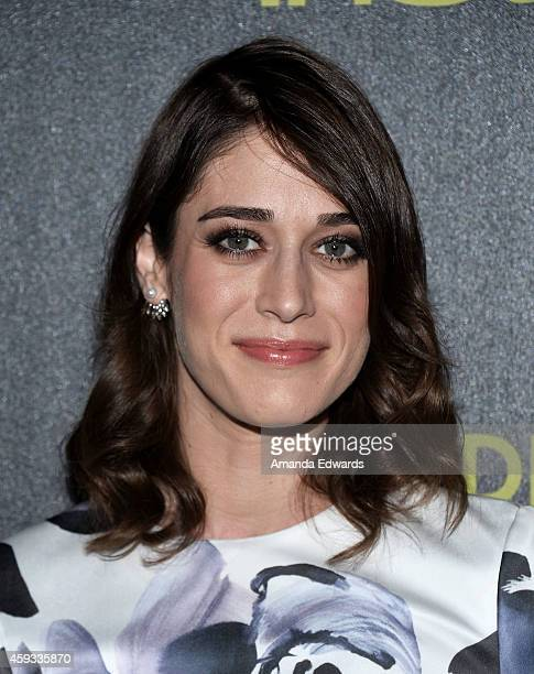 Actress Lizzy Caplan arrives at The Hollywood Foreign Press Association and InStyle's 2015 Golden Globe Award Season celebration at Fig Olive Melrose...