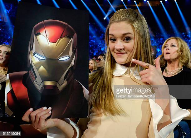 Actress Lizzy Greene poses with an Iron Man poster at Nickelodeon's 2016 Kids' Choice Awards at The Forum on March 12 2016 in Inglewood California